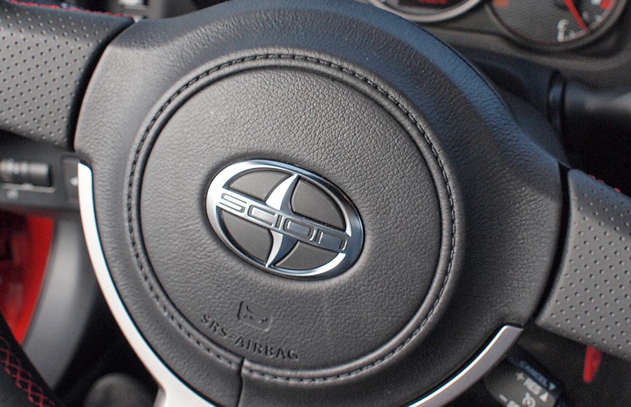 The steering wheel-mounted airbag in a 2015 Scion FR-S