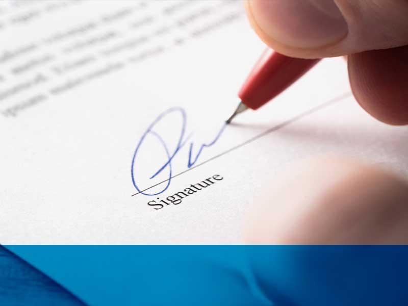 signing a purchase contract at OpenRoad Auto Group